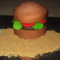 Krabby Pattie Krabby patty cake! air brushed. burger is top of choch cake and lettuce and tomatoe painted fondant. thanks for looking!