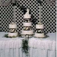Kelly And Andy's Cake This cake a main cake with two side cake. One side cake was carrot cake. I made candy ovals to decorate the tiers, all were made one at a...