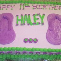 Birthday Cake With A Pair Of Old Navy Flip Flops Made From Icing She wanted Bright Colors, so the Cake is covered in PINK, then trimmed in Bright Green, & Purple decorations. I cut a flip flop design...