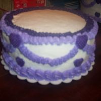 Round Double Layer Cake With Handmade Candy Hearts This is one Tier of a Wedding Cake I made. I thought this would make a Very Pretty Birthday Cake or cake for other occassions.The hearts I...