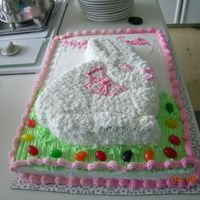 Easter Bunny  Easter cake made for family. Vanilla bunny, chocolate sheet. All buttercream. Left it out in the sun too long and the colors started to...