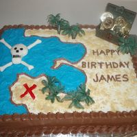 Pirate Birthday Cake Water is made with blue icing and sand look is made with nilla wafers. Skull is made with fondant and drew on with black ediable marker.