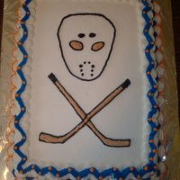 Father's Day Cake  Skull & cross bone theme using a hockey mask & crossed hockey sticks.My hubby is a HUGE hockey fan, so I searched for hockey images...
