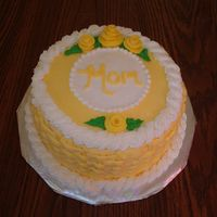 Mom's Birthday Cake   White cake w/ cannoli filling from the Cake Mix Doctor Book. All buttercream frosting with Duff's Fondant Roses.