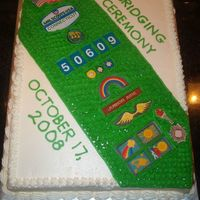 Girl Scout Sash Cake  I made this cake for my daughter's Jr. Girl Scout Troop's bridging ceremony using the troop sash as a model for the cake. I &quot...
