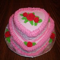 Valentine's Heart Cake  White Almond Sour Cream cake with buttercream frosting. The roses are fondant. This was my first attept at basetweave since I took Wilton 2...