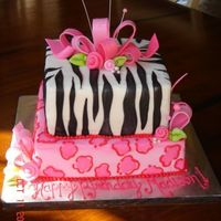 Girly Animal Print Birthday Cake Pink leopard print and zebra print cake made for 11 year old birthday girl.