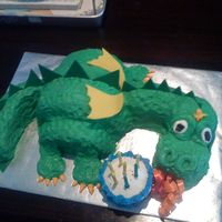 "Dragon Birthday Cake  This was my first time doing a sculpted cake. The dragon's ""fire"" is supposed to be lighting the candles on the mini-..."