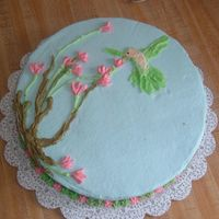 Hummingbird With Sweet Peas I made this cake for my Grandma, just for extra practice while in course one. It is butter pecan cake with buttercream icing.