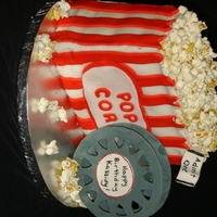 Popcorn And A Movie This is a pumpkin spice cake with crusting cream cheese frosting covering in cinnamon fondant. The movie reel was made from gumpaste and...