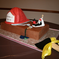 Burnin' Love the bride said she wanted the topper on the groom's cake. He was a volunteer fireman. He had a dog. They are man's bestfriend. I...
