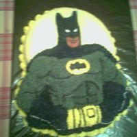 Batman Cake   This is a cake I made for my husband's birthday. The cake is a regular yellow cake with buttercream icing.