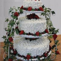 Fresh Fruit  French vanilla cake with vanilla mousse and fresh strawberry filling. Buttercream and fresh fruit decorations. Bride provided a picture - I...