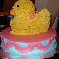 Rubber Duckie Baby Shower Cake I used the 3d duckie pan, first cake i made with the pan i took it out too early and had to make another cake . The duck is cover in...