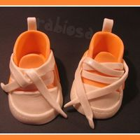Baby Sneackers   The shoes are made out of gumpaste. I had fun making them! Thanks for looking!