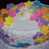 Course 2 - Final Cake I really like the look of the basket weave. My royal icing flowers did not like the drive home from class - should have taken some extra...