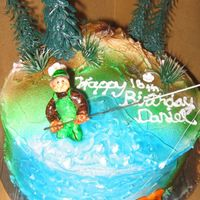 Fly Fisherman Cake This was for a friend who's son loves fly fishing. The fish is my attempt at a trout LOL... I see you guys... stop laughing!....