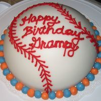Baseball Birthday Cake  This was my first time working with fondant. I thought it came out pretty good. It was for my Grandpa's 84th Birthday. I put some blue...