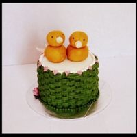 "Chicks Iced in buttercream, marzipans chicks. I got the idea from the Kate Sullivan book. 5"" cake."