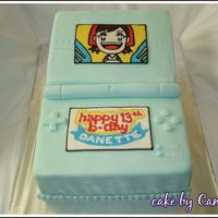 Nintendo Ds Cake I made for my cousin in Mar 08. First time trying FBCT - the picture of Mama came out well but my attempt on turning the logo into the...
