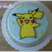 I Choose You, Pikachu! All fondant work. And this was a last minute job too! I cut out basic shape and then added the other details afterwards. For the border I...