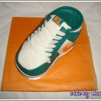 Nike Shoe Nike shoe for my buddy made in Feb 08This was my first real 3D cake. and I was definitely proud of this one. had a lot of help from bdrider...