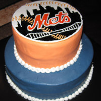 Met's Birthday Cake Was asked to make a cake for a Mets fan. Hand painted and piped the logo on a round piece of pastillage I made. Glued it on the cake using...