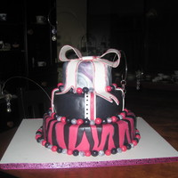 More Pink And Black After seeing the other pink and black cake, a girl wanted me to make her a cake for her 12th birthday. So I did a zebra that she wanted and...
