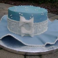 Blue Hat An eight inch cake with a brim made of a fondant gumpaste blend. Thanks for looking!