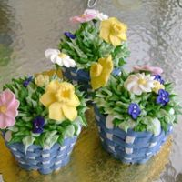 Baskets Of Flowers jumbo cupcakes with basket weave and royal icing flowers... Thanks for looking!