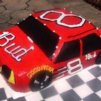 Race Car Cake sculpted cake iced in buttercream and air brushed red... thanks for looking!