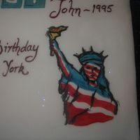 25Th Anniversary I used food colouring to paint the statue of liberty on the cake.