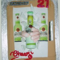 Bacardi Breezer 3D bottle and hand coming out of a fridge, splinters of glass flying, chocolate cake .decorated with fondant