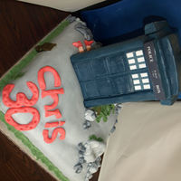 Dr Who Tardis Chocolate base cake decorated with fondant to look like stone or rocky area, tardis is made with rice krispie inners for vertical support...