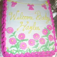 Welcome Haylee Baby Shower for my niece. I had to redo the writing and made a mess so I had to add flowers to cover up. All buttercream with fondant...