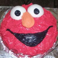 Elmo Birthday Cake Chocolate cake with whipped cream frosting and fondant eyes.