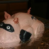 Incredi-Pig Cake covered in buttercream with fondant accents.