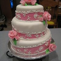 Pink Delight  I got this idea from http://www.sugarcreations.com/ . Thank you Rebecca Sutterby for the idea. The cake is covered in fondant with royal...