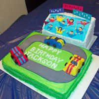Race Track And Stands 9x13 race track with buttercream and fondant track. 3D carved cars with fndant icing. Stand was carved from a sheet cake with royal icing...