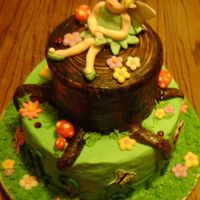 Baby Tinkerbell I've been wantin to make a fairy cake for awhile.... Chocolate cake with fresh strawberries and buttercream filling. I traded a tattoo...