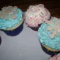 Christmas Cupcakes snowflakes are made out of white chocolate that I free hand piped and painted with luster dust. The red and white ones are red velvet with...