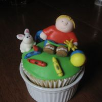 A Boy's Favorite Things A made this large cupcake decorated with my 4 year old's favorite things -- a bunny, crayons, beach ball, worms and a baseball (in...