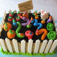 Wormy Garden Party W Fence This was party number two. This time I did the cake with a gum paste fence. Much easier than the fondant grass.