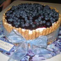 "Blueberries And Pirouette Cookies This is a double layer 10"" doctored yellow cake. It is iced in buttercream, and filled with blueberry pie filling mixed with..."