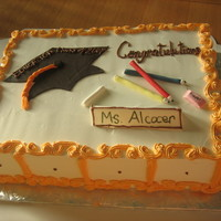 Teacher Graduates yellow cake/pina colada filling w/nuts/whipped frosting. sister in law graduation cake with fondant accents everything is edible