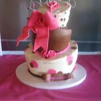Girly Baby Shower chocolate/strawberry/vanilla cakes all with strw. filling/bc frosting. this was my attempt to a mad hatter whimsical cake. fondant accents...