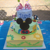 Minnie Mouse Clubhouse My niece's first bday. 1st tier choco/straw filling 2nd tier strawberry/straw filling 3rd tier pina colada. all bc with fondant...