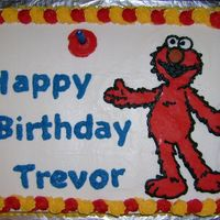 Elmo! I actually tried many new things with this cake - the cake is WASC (which is SO good, btw!)- I used the Buttercream Dream recipe for the...
