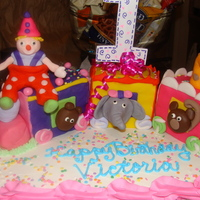 Circus Train Cake  Circus Train Cake I made for a clients who's child loves clowns. I learned how to make this cake from Debbie Brown...she is awesome....