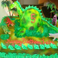 Dino Cake This cake was fun to make. Little 5 year old boy loved dinosaurs. 1/2 sheet chocolate cake with a fondant covered wilton doll cake pan....